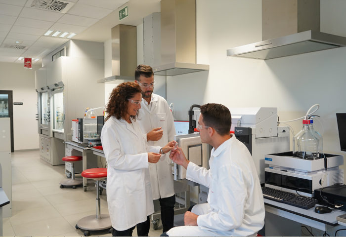 three analysts discuss the results of a polymer analysis