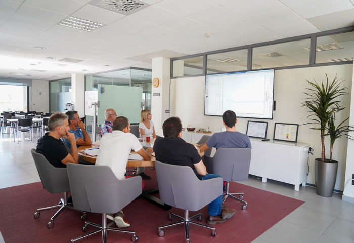 staff gathering around a screen to view a presentation