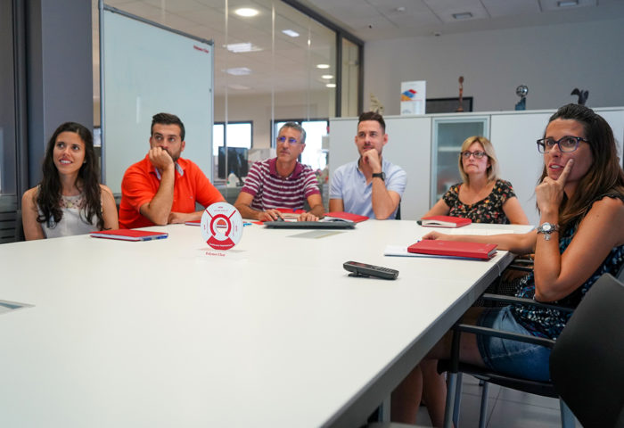 six chemists meeting at polymer char for a weekly review of their tasks