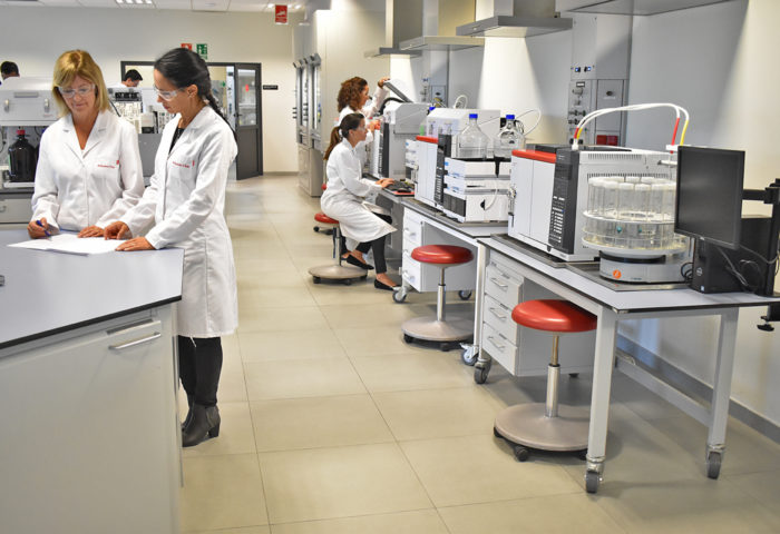 four chemists preparing analytical services